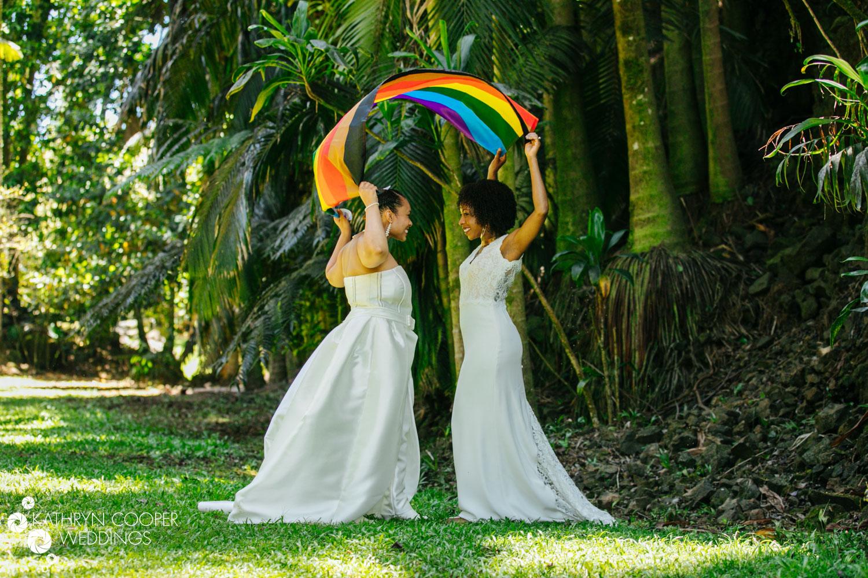 Rainbow flag wedding two brides in Big Island, HI eloping at Reed's Island