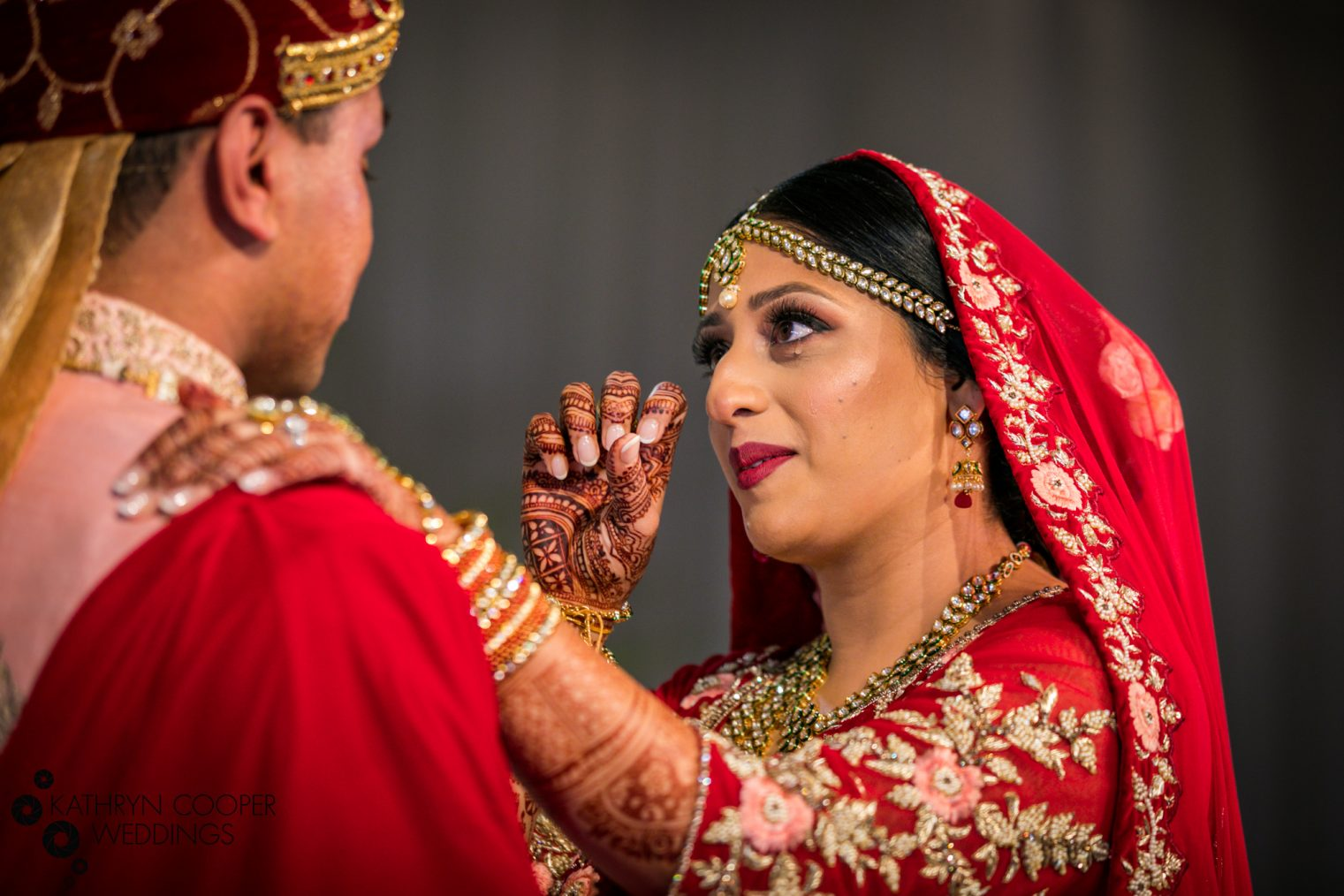 Tears during first look at Indian wedding photography Kathryn Cooper punjabi