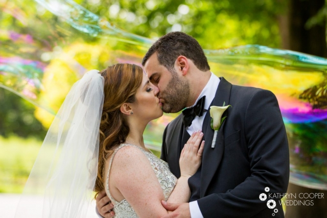 Kissing under a big bubble in Central Park New york city