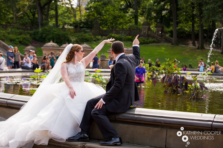 Bethesda Fountain elopement wedding photographer throwing coins in
