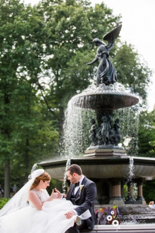 Bride and Groom Playing games under Bethesda Fountain in central park