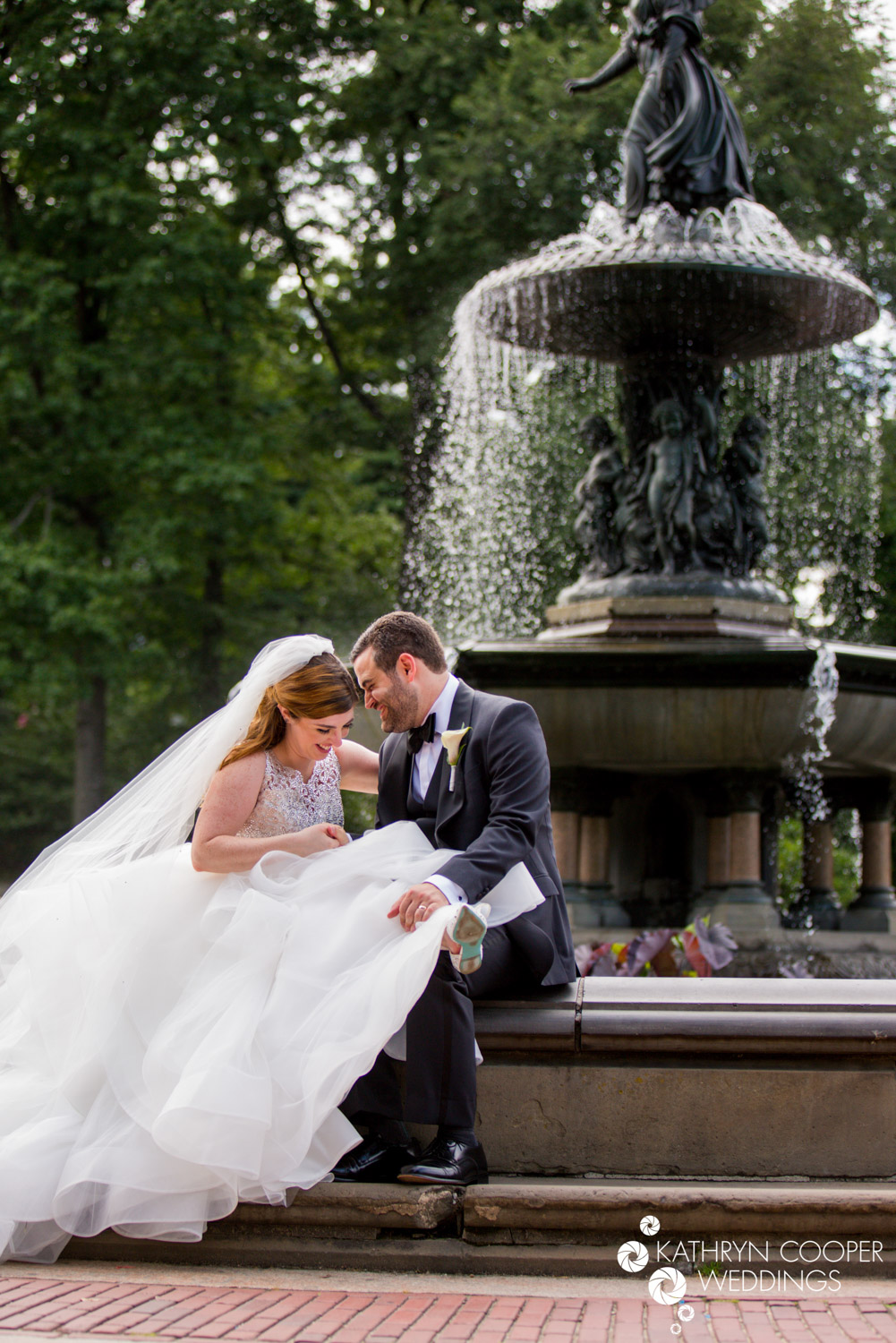 NYC elopement photographer catches cute bride and groom under Bethesda Fountain