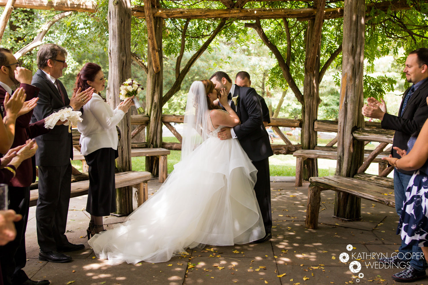 First kiss after wedding in Manhattan's central park NYC