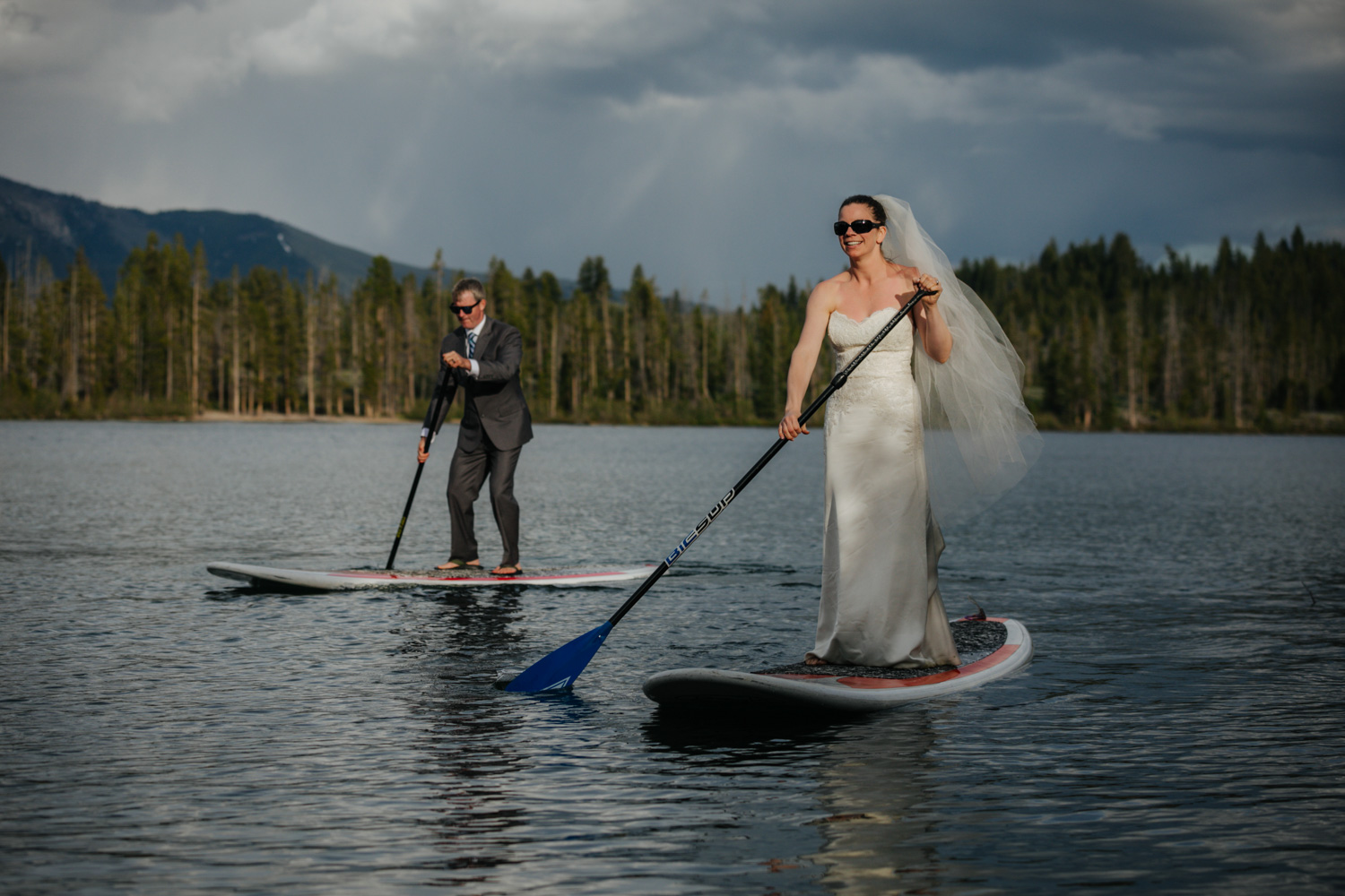 Unique bridal portraits stand up paddleboarding