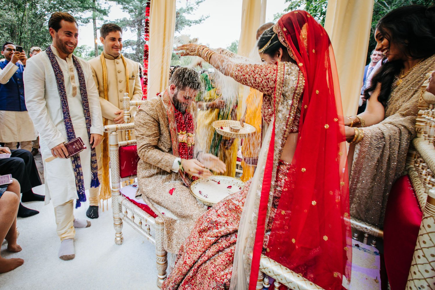 Throwing rice Indian wedding The Tides