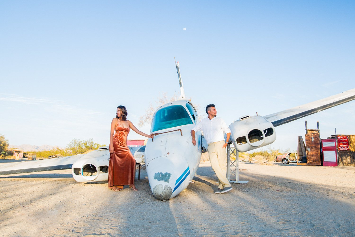 Engagement photo poses with a plane